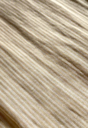 Closeup swatch of tan and white stripe fabric.