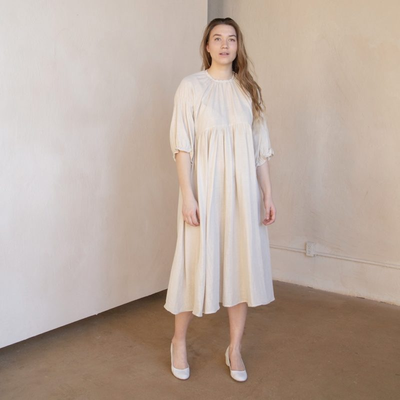 Front shot of straight size model in tan and white striped cotton Kacy Dress
