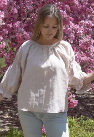 Front view of straight size model in Doja Blouse in Sandstone Stripe. Standing in front of lilac tree.