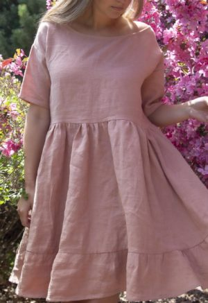 Closeup front view of straight size model in Peach Linen Wilcox Dress