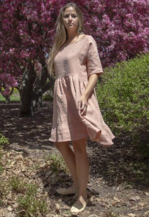 Front view of straight size model in Peach Linen Wilcox Dress