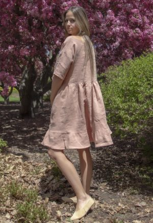 Side view of straight size model in Peach Linen Wilcox Dress