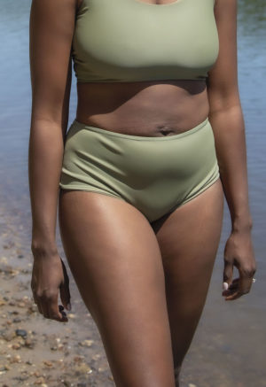 Front shot of straight size model on the beach in Scoop Wrap Top and Hipster Bottoms in Wild Sage Green.
