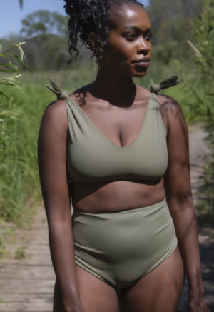Closeup front shot of straight sized model in Shoulder Tie Top and High-Waisted Bottoms in Wild Sage Green.