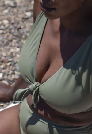 Closeup side shot of straight size model in Sporty High-Waisted Bottoms and Two-Way Top in Wild Sage Green.