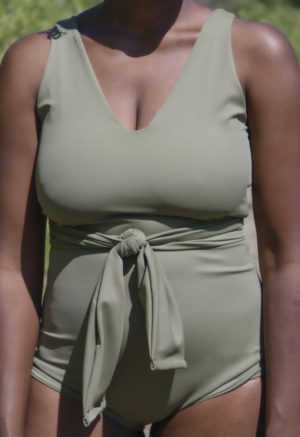 Closeup shot of straight size model in Wrap One Piece in Wild Sage Green.