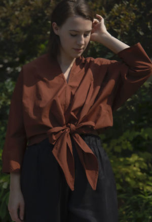 Front view of straight size model wearing Bow Top in Burnt Umber.