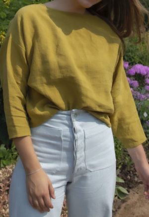 Front view of straight size model wearing Cropped Pullover in Avocado Linen.