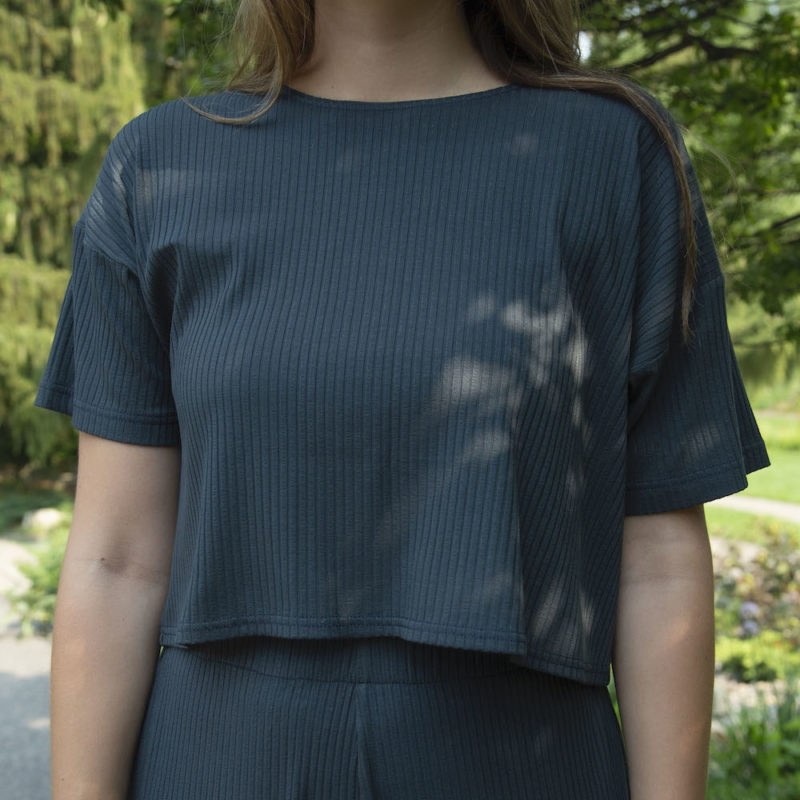 Close up front view of straight size model wearing Cropped Tee in Blue Spruce Rib.