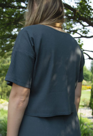 Back view of straight size model wearing Cropped Tee in Blue Spruce Rib.