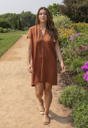 Front view of straight size model wearing Double V Kaftan in Copper Lyocell.