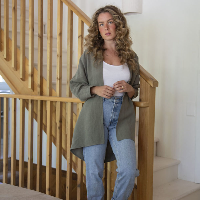 Front view of straight size model wearing Easy Jacket in Moss Linen.