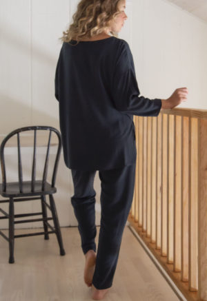 Back view of straight size model wearing Easy Tapered Pant in Liquorice Lyocell.