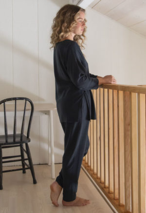 Side view of straight size model wearing Easy Tapered Pant in Liquorice Lyocell.