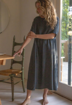 Front view of straight size model in Gathered Midi Dress in Liquorice Lyocell.