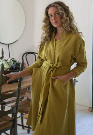 Front view of straight size model wearing Lapel Midi Jacket in Avocado Linen.