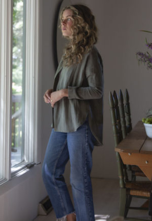 Side view of straight size model wearing the Modernist Jacket Top in Moss Linen.