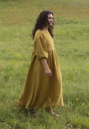 Side view of straight size model in Oversized Dress in Avocado Linen.