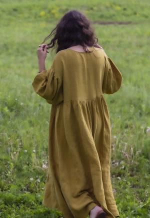 Back view of straight size model in Oversized Dress in Avocado Linen.