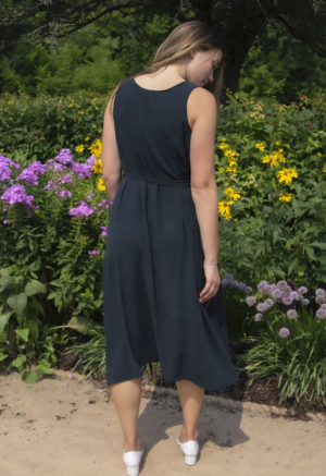Back view of straight size model wearing Reversible Scoop Dress in Liquorice Lyocell.