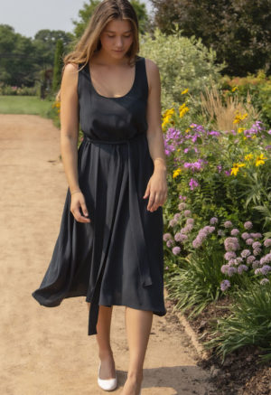 Front view of straight size model wearing Reversible Scoop Dress in Liquorice Lyocell.