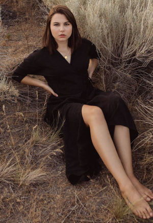 Front view of straight size model in Reversible Wrap Dress in Black Lyocell.