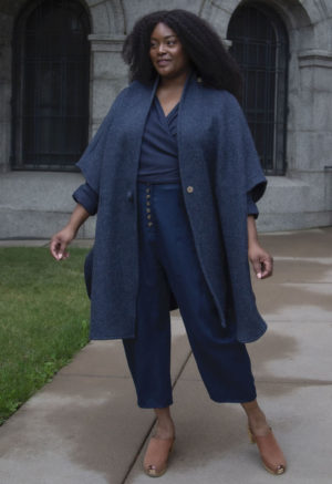 Front view of plus size model wearing Shawl Wrap in Midnight Wool.