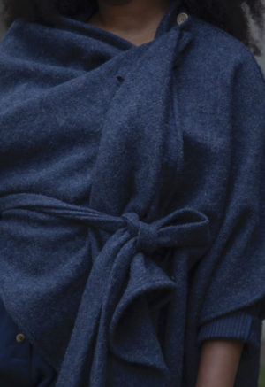Close up front view of plus size model wearing Shawl Wrap in Midnight Wool.
