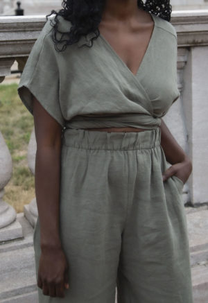 Front view of straight size model wearing Short Sleeve Tie Top in Moss Linen.