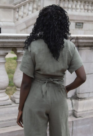 Back view of straight size model wearing Short Sleeve Tie Top in Moss Linen.