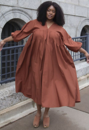 Front view of plus size model wearing Tiered Midi Dress in Burnt Umber.