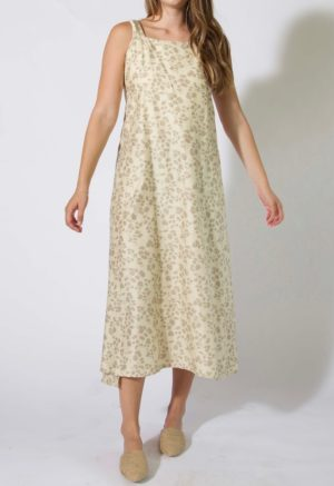 Front view of straight size model wearing Sustain Overlap Dress in Almond Floral Print