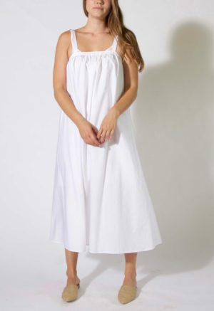 Front view of straight size model wearing Maxi Dress in white cotton.