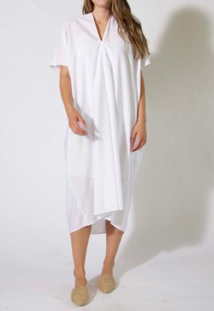 Front view of straight size model wearing Sample 421, a midi length kaftan, in white cotton.