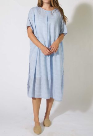 Front view of straight size model wearing Pleated Kaftan Dress.
